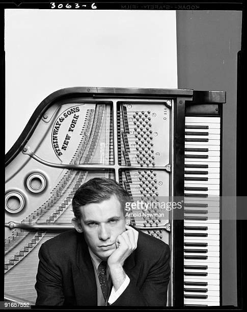 Portrait of Canadian pianist Glenn Gould as he poses in front of a Steinway & Sons piano, New York, New York, October 10, 1959.