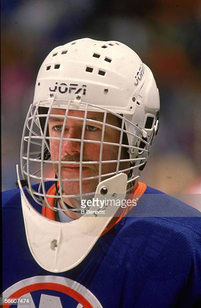 Portrait of Canadian pro hockey player Billy Smith goalie for the New York Islanders during a road game 1980s