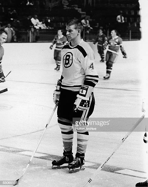 Portrait of Canadian professional ice hockey player defenseman Bobby Orr of the Boston Bruins on the ice with stick skates and gloves during a game...
