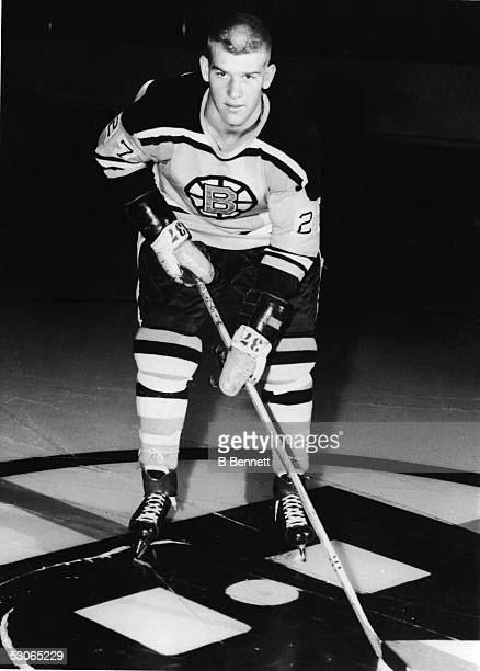 Portrait of Canadian professional ice hockey player defenseman Bobby Orr of the Boston Bruins at the ready on the ice with stick skates and gloves...