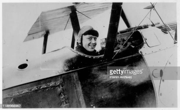Portrait of Canadian Royal Naval Air Service fighter pilot Raymond P Collishaw as he sits in the cockpit of a plane, 1917.