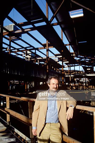 Portrait of CanadianAmerican architect Frank Gehry as he poses at the construction site of one of his buildings California January 1980