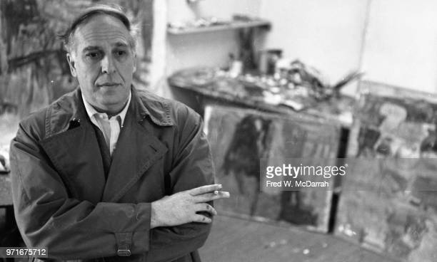 Portrait of Canadianborn American abstract expressionist painter Philip Guston as he stands arms crossed in his studio New York New York April 14 1961