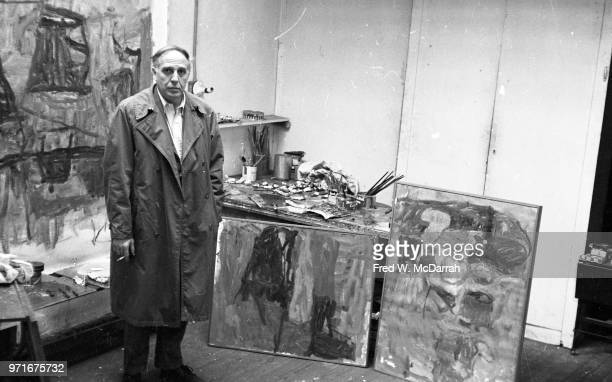 Portrait of Canadianborn American abstract expressionist painter Philip Guston as he stands in his studio New York New York April 14 1961