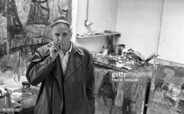 Portrait of Canadianborn American abstract expressionist painter Philip Guston as he smokes a cigarette in his studio New York New York April 14 1961