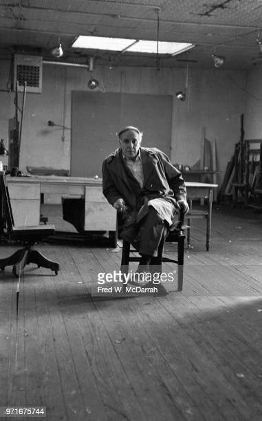 Portrait of Canadianborn American abstract expressionist painter Philip Guston as he sits in a chair in his studio New York New York April 14 1961