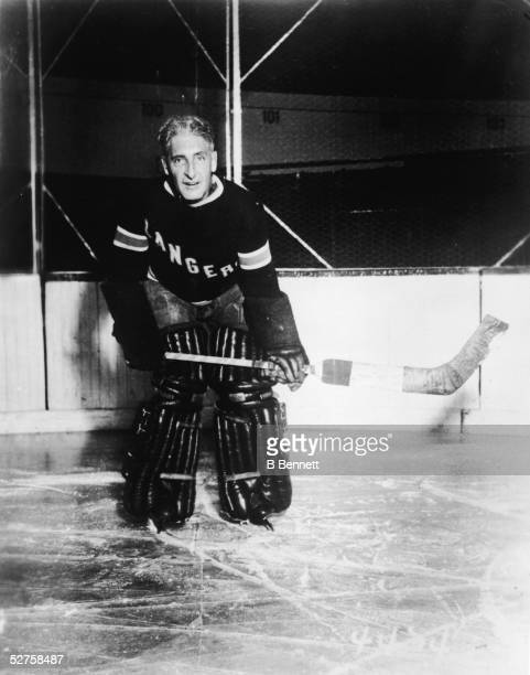 Portrait of Canadian-born professional hockey player, coach, and general manager Lester Patrick of the New York Rangers, posed on the ice and dressed...