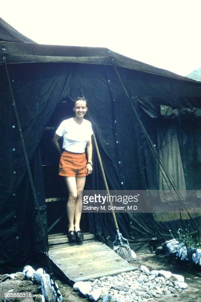 Portrait of Captain 'Crickett' Craig of the 8063rd MASH as she stands as the entrance to a tent South Korea August 1952