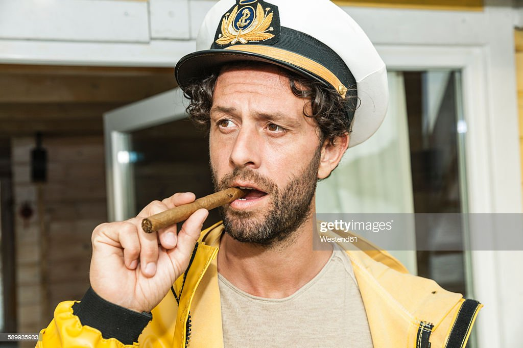 Portrait of captain with cigar : Stock Photo