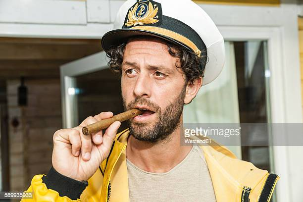 portrait of captain with cigar - sailor hat stock pictures, royalty-free photos & images