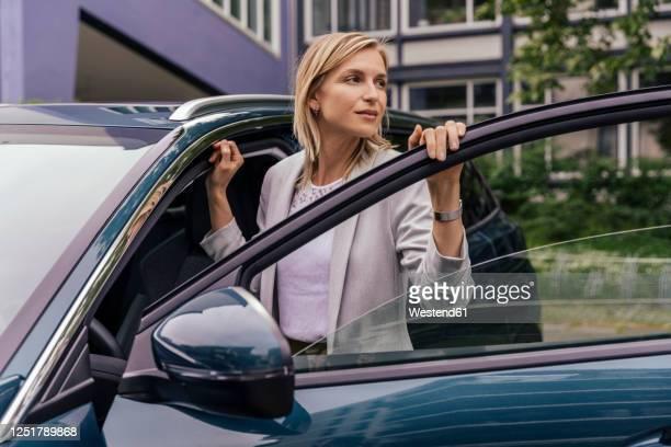 portrait of car driver looking at distance - eintreten stock-fotos und bilder