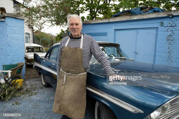 portrait of car restorer and classic 1950s american sedan - 20th century stock pictures, royalty-free photos & images
