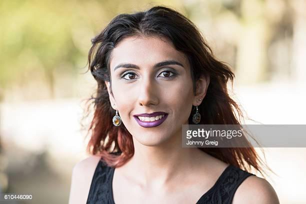 Portrait of carefree transgender female smiling