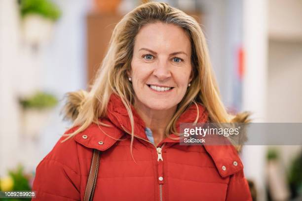 portrait of carefree woman - one mature woman only stock pictures, royalty-free photos & images