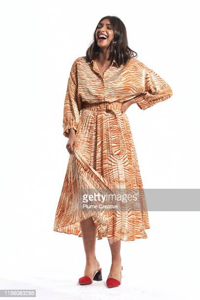 portrait of carefree woman - robe longue photos et images de collection