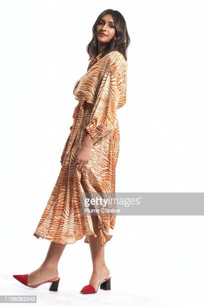 portrait of carefree woman - cut out dress stock pictures, royalty-free photos & images