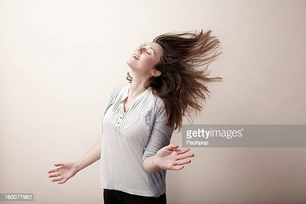 portrait of carefree woman - windswept stock pictures, royalty-free photos & images