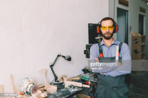 portrait of carpenter at the workshop - martin dm stock pictures, royalty-free photos & images