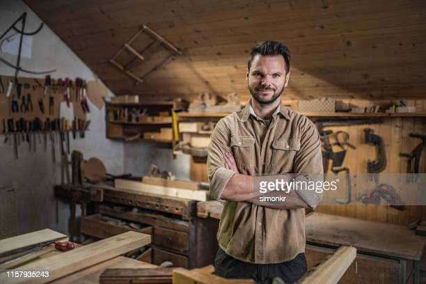 portrait of carpenter in workshop - khaki stock pictures, royalty-free photos & images