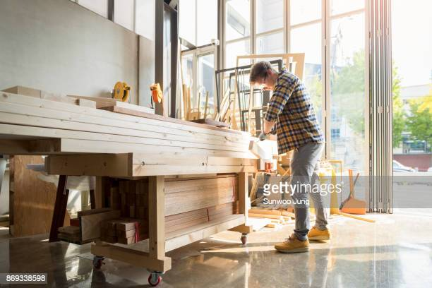 portrait of carpenter in workshop - construction material stock pictures, royalty-free photos & images