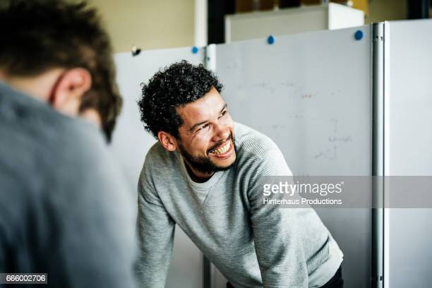 portrait of casual businessman during meeting - bürokleidung stock-fotos und bilder
