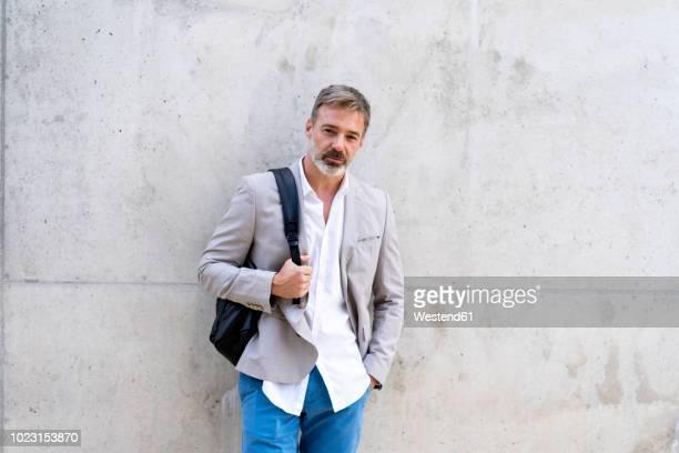 portrait of casual businessman with backpack - homem 45 anos imagens e fotografias de stock