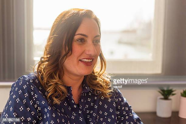 Portrait of Casually Dressed New Zealand Business Woman Meeting