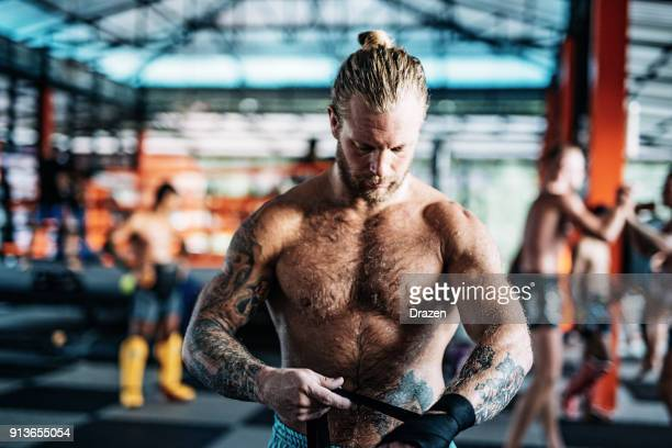 portrait of caucasian adult man preparing mma and kick boxing - hairy man stock pictures, royalty-free photos & images