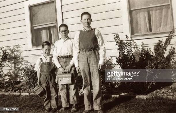 portrait of caucasian brothers posing near house - archival photos stock pictures, royalty-free photos & images