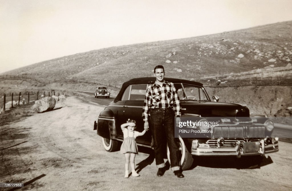 Portrait of Caucasian father and daughter posing near vintage car : Stock Photo