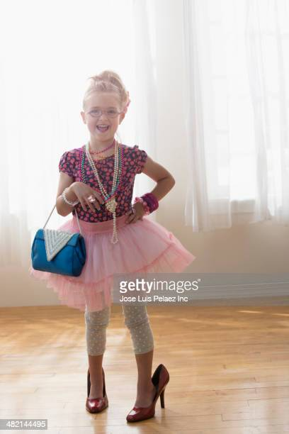 Portrait of Caucasian girl dressed up in tutu and high heels