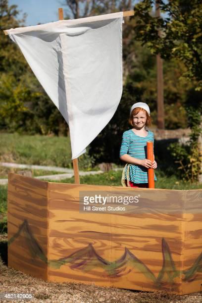 Portrait of Caucasian girl in pretend pirate ship