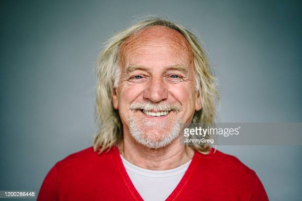 portrait of caucasian male senior wearing red sweater - v neck stock pictures, royalty-free photos & images