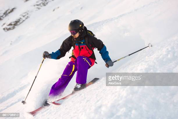 Portrait of caucasian male skier riding downhill
