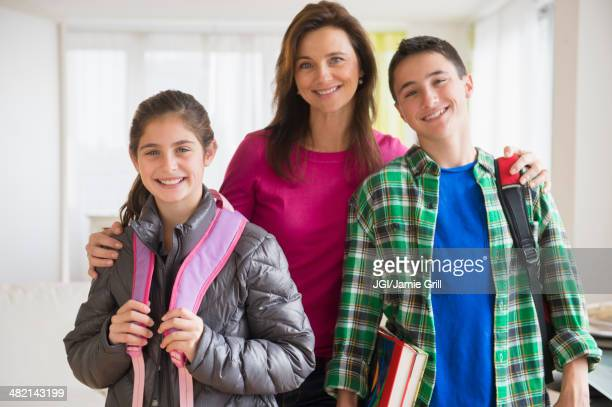 Portrait of Caucasian mother and children with backpacks