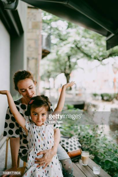 Portrait of caucasian mother and mixed race daughter