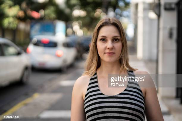 portrait of caucasian woman at street - 30 34 years stock pictures, royalty-free photos & images