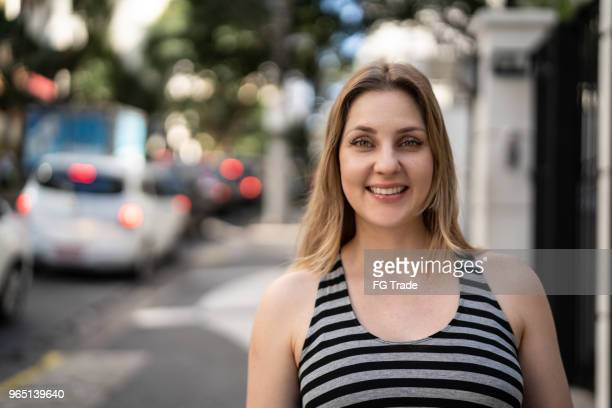 portrait of caucasian woman at street - brazilian culture stock pictures, royalty-free photos & images