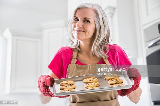 Portrait of Caucasian woman holding baked cookies
