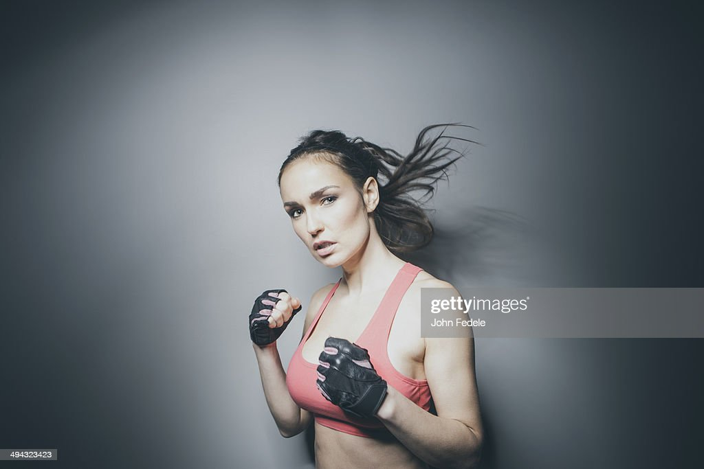 Portrait of Caucasian woman in fighting stance : Stock Photo