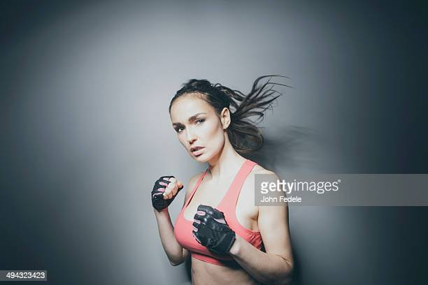 Portrait of Caucasian woman in fighting stance
