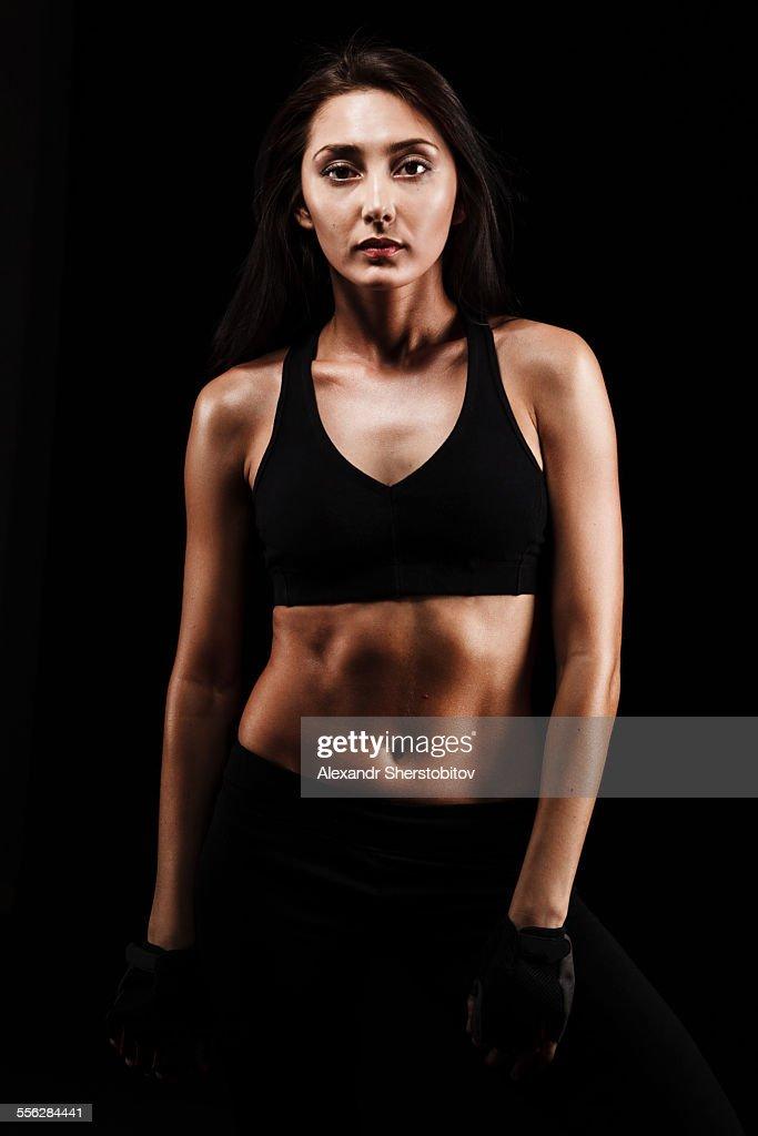 Portrait of Caucasian woman in sport-bra : Stock Photo
