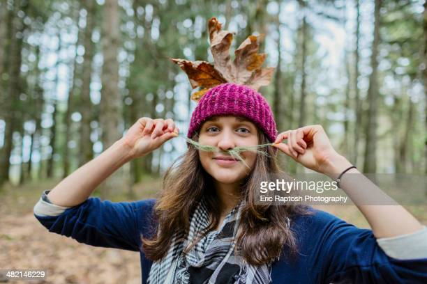 portrait of caucasian woman playing with leaves - eugene oregon stock photos and pictures