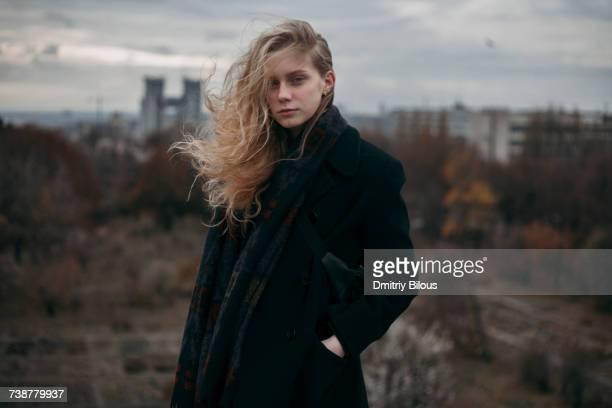portrait of caucasian woman with hair blowing in wind - anorak abrigo de invierno fotografías e imágenes de stock