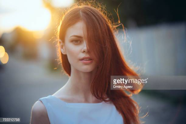 portrait of caucasian woman with hair covering face - femme rousse photos et images de collection