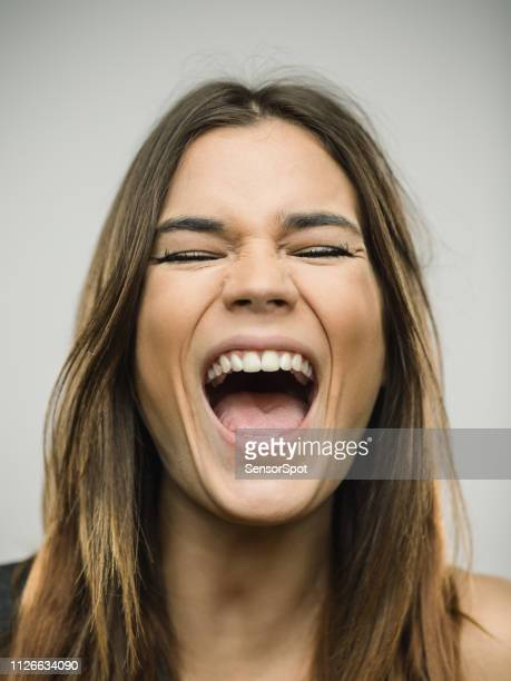 portrait of caucasian young woman with very excited expression and eyes closed - mouth open stock pictures, royalty-free photos & images