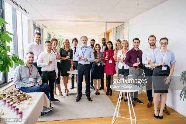 portrait of ceo and executive team at office celebration - ethnicity stock pictures, royalty-free photos & images