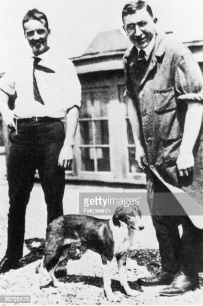 Portrait of Charles Best and Frederick Banting and dog circa 1920s