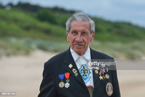 A portrait of Charles Norman Shay a Native American a Penobscot tribal elder and a veteransoldier from WWII as he looks at the Omaha Beach when he...