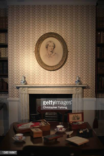 A portrait of Charlotte Bronte hangs above the fireplace in the dining room of the Bronte Parsonage Museum on February 8 2012 in Haworth England The...